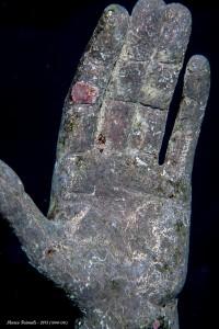 L'effetto dell'idropulizia sulla mano del Cristo degli Abissi